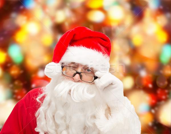 close up of santa claus winking Stock photo © dolgachov