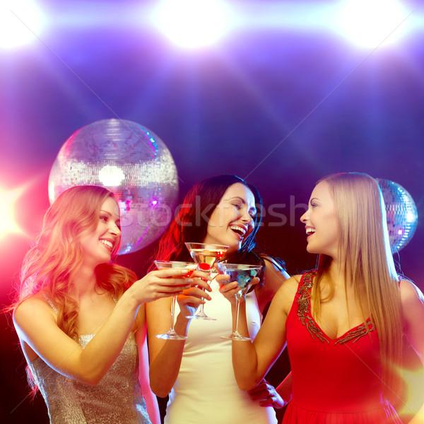Trzy uśmiechnięty kobiet koktajle disco ball nowy rok Zdjęcia stock © dolgachov