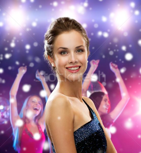 Sorrindo vestido de noite férias festa pessoas discoteca Foto stock © dolgachov