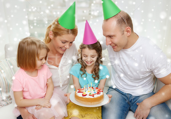 happy family with two kids in party hats at home Stock photo © dolgachov