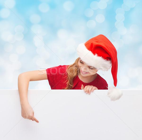 Lány mikulás segítő kalap fehér tábla karácsony Stock fotó © dolgachov