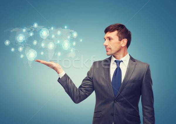 Tanár mutat világtérkép hologram üzlet iroda Stock fotó © dolgachov