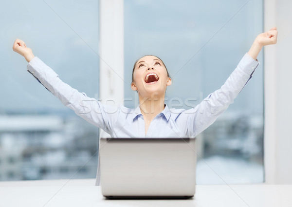 Stock photo: screaming businesswoman with laptop in office