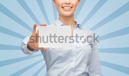 Gülen işkadını beyaz boş kart iş adamları Stok fotoğraf © dolgachov