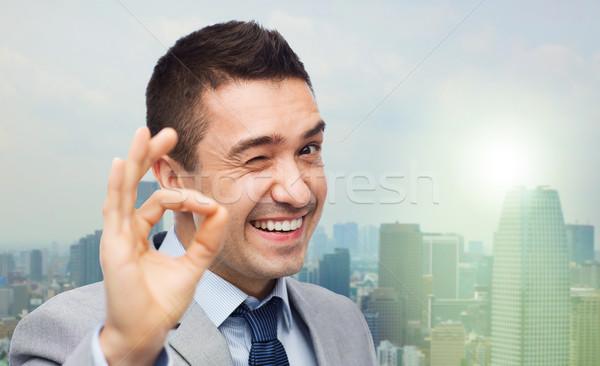 幸せ ビジネスマン スーツ 印相 ストックフォト © dolgachov