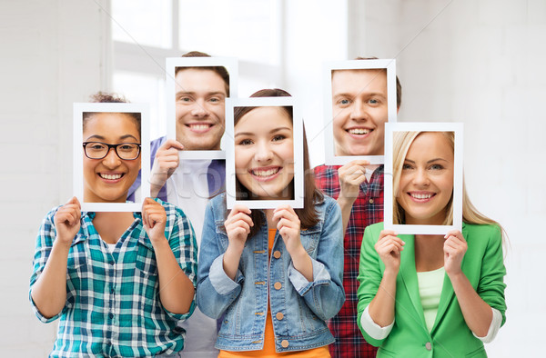 friends or students covering faces with papers Stock photo © dolgachov