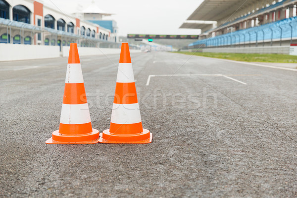 traffic cones on speedway of stadium Stock photo © dolgachov