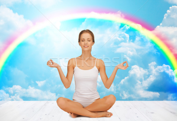 Nő meditál jóga lótusz póz emberek Stock fotó © dolgachov