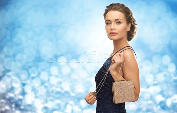 Mulher vestido de noite pequeno saco pessoas férias Foto stock © dolgachov