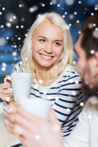 Boldog pár megbeszélés iszik tea kávé Stock fotó © dolgachov