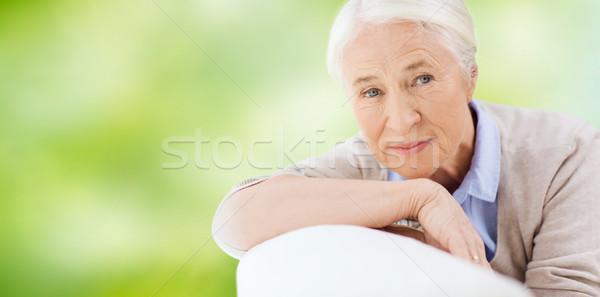 happy senior woman resting on sofa Stock photo © dolgachov
