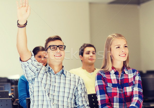 Stock photo: group of smiling students in lecture hall