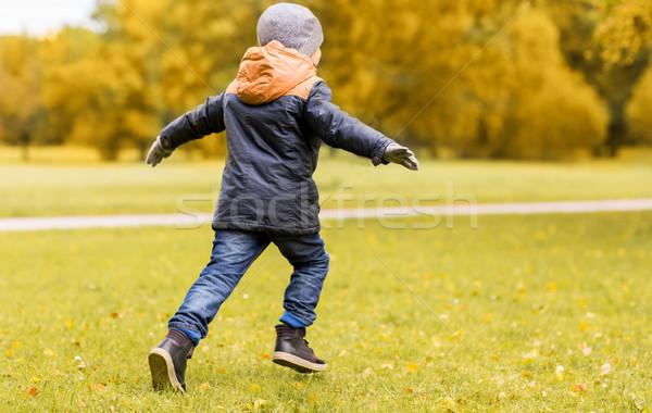 little boy running outdoors Stock photo © dolgachov