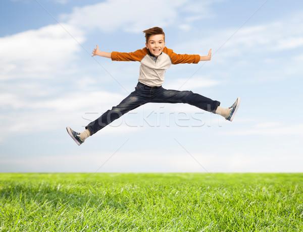 Сток-фото: счастливым · улыбаясь · мальчика · прыжки · воздуха · счастье