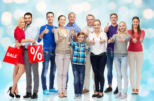 Grupo pessoas felizes gesto venda Foto stock © dolgachov
