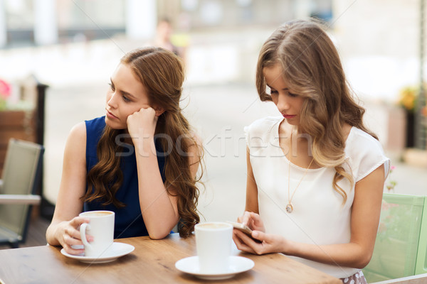 women with smartphones and coffee at outdoor cafe Stock photo © dolgachov