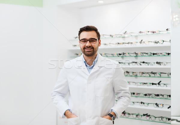 Férfi optikus szemüveg kabát optika bolt Stock fotó © dolgachov