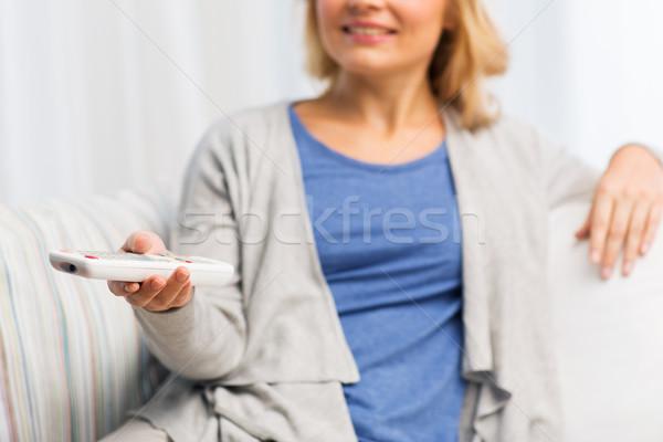 Femme contrôle maison télévision Photo stock © dolgachov