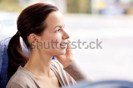 Mutlu kadın seyahat otobüs çağrı Stok fotoğraf © dolgachov