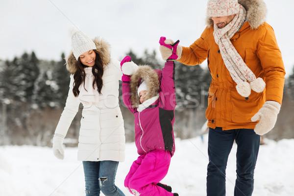 счастливая семья зима одежды ходьбе улице Сток-фото © dolgachov