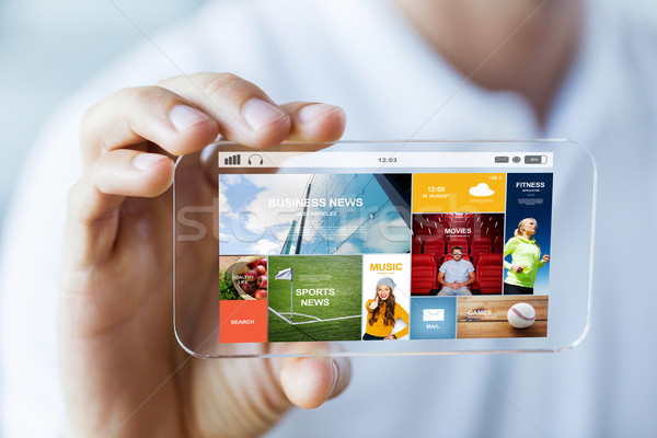 Stock photo: close up of male hand with news on smartphone
