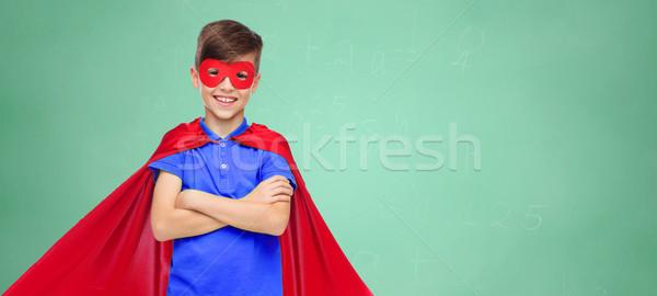 Fiú piros szuperhős maszk oktatás gyermekkor Stock fotó © dolgachov