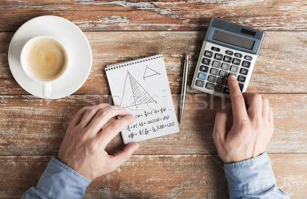 close up of hands with calculator solving task Stock photo © dolgachov