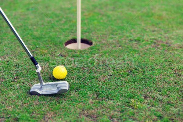close up of club and ball near hole on golf field Stock photo © dolgachov