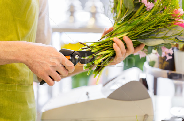 close up of florist man with flowers and pruner Stock photo © dolgachov