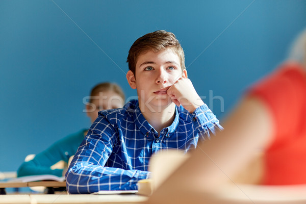group of students with notebooks at school lesson Stock photo © dolgachov