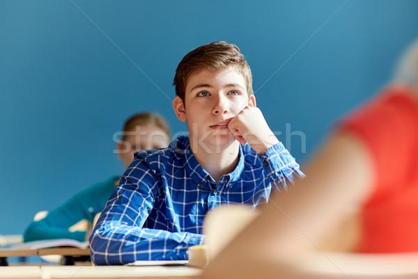 Csoport diákok jegyzetfüzetek iskola lecke oktatás Stock fotó © dolgachov
