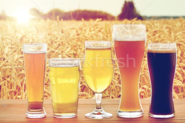 Diverso occhiali tavola fabbrica di birra bevande Foto d'archivio © dolgachov