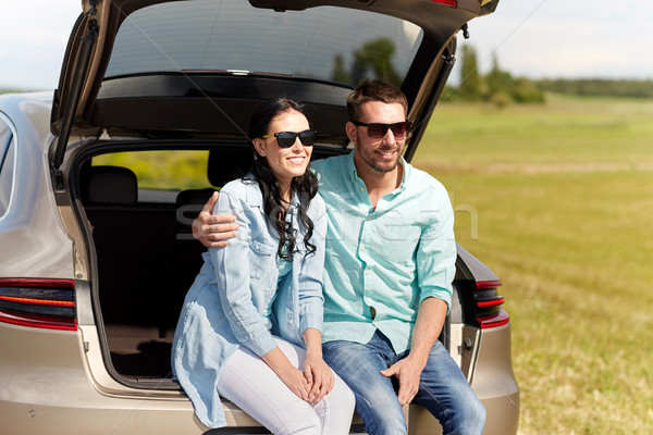 happy couple hugging at open hatchback car trunk Stock photo © dolgachov