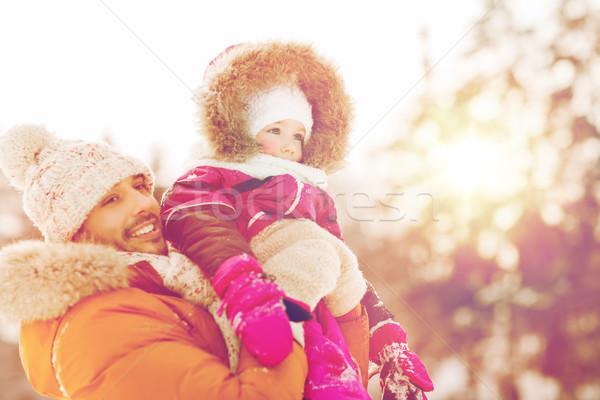 happy family in winter clothes outdoors Stock photo © dolgachov