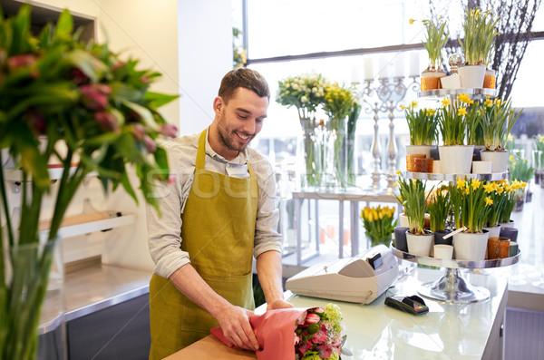 Fleuriste fleurs papier personnes Photo stock © dolgachov