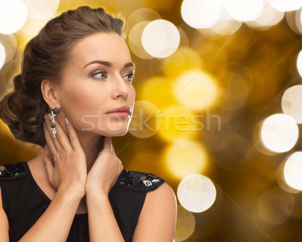 Nő estélyi ruha fülbevaló emberek ünnepek ékszerek Stock fotó © dolgachov