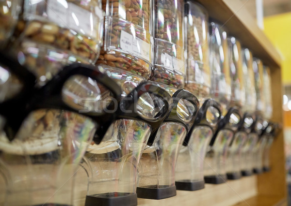 row of jars with nuts and seeds at grocery store Stock photo © dolgachov