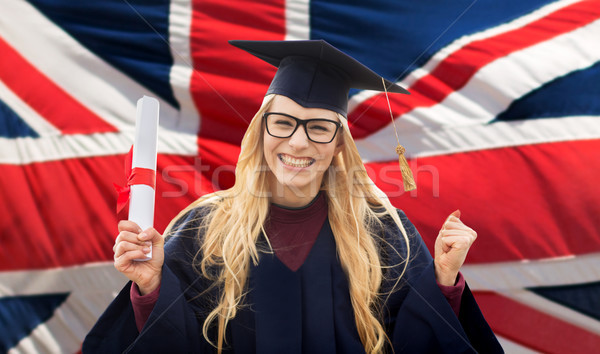happy student with diploma over british flag  Stock photo © dolgachov