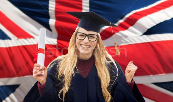 Mutlu öğrenci diploma İngiliz bayrağı eğitim jest Stok fotoğraf © dolgachov