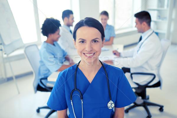 Boldog orvos csoport kórház egészségügy hivatás Stock fotó © dolgachov