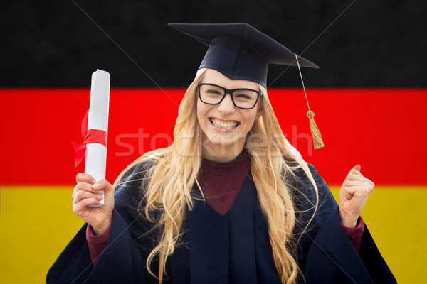 happy female student with diploma over german flag Stock photo © dolgachov