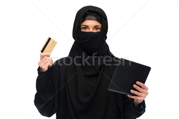 woman in hijab with tablet pc and credit card Stock photo © dolgachov