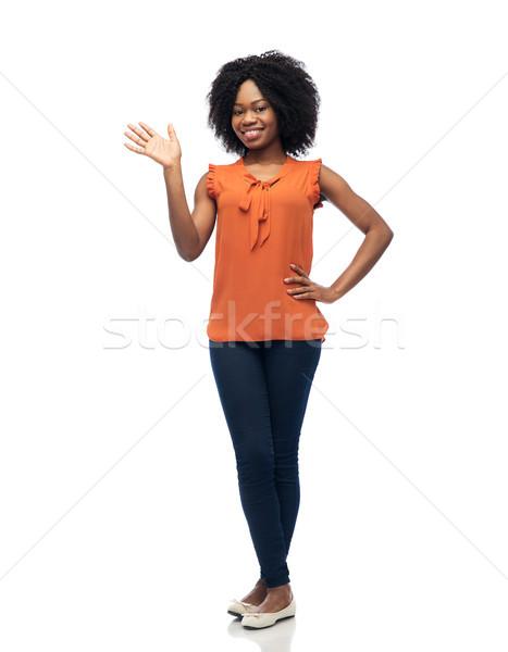 happy african woman waving hand over white Stock photo © dolgachov
