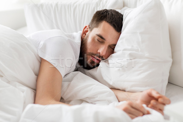 close up of man sleeping in bed at home Stock photo © dolgachov