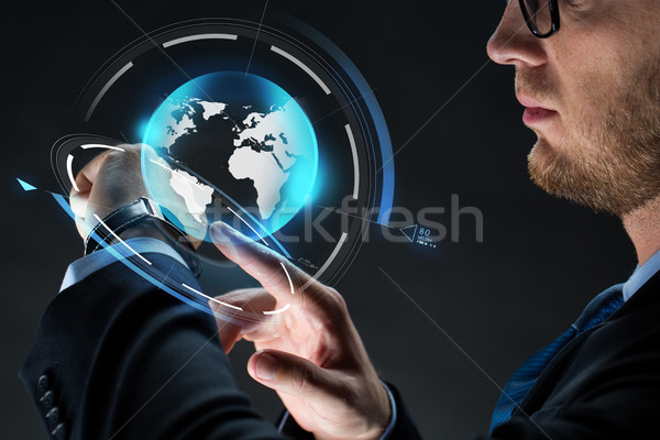 close up of businessman with smartwatch Stock photo © dolgachov