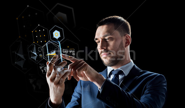 бизнесмен смартфон виртуальный бизнеса реальность будущем Сток-фото © dolgachov