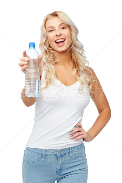 happy beautiful young woman with bottle of water Stock photo © dolgachov