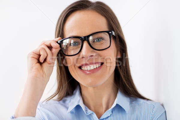 Uśmiechnięty okulary ludzi działalności Zdjęcia stock © dolgachov