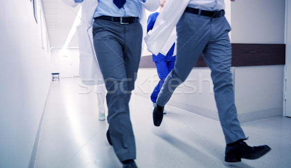 close up of medics or doctors running at hospital Stock photo © dolgachov