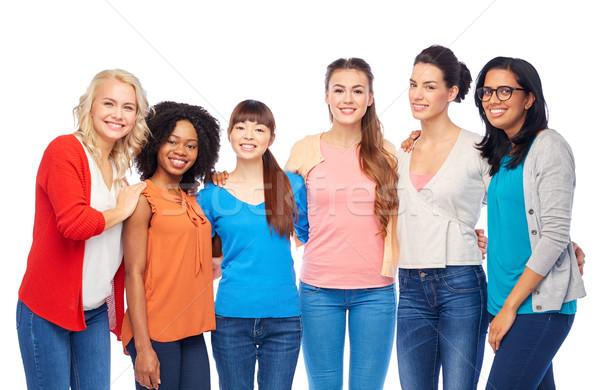 international group of happy women hugging Stock photo © dolgachov